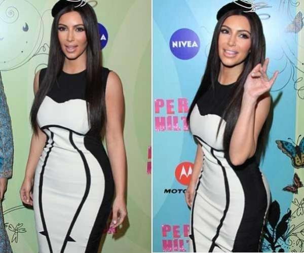 Kim sigue engordando y casi revienta un vestido 11