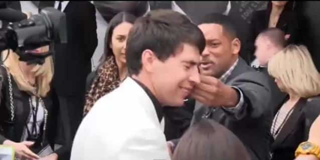 Will Smith le pegó a un reportero que intentó darle un beso en la boca 17