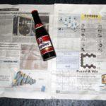 Como abrir una botella de cerveza con una hoja de periódico o un billete 10
